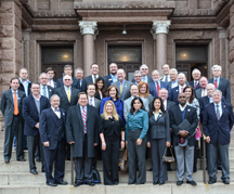 Bankers in front of Texas State Capitol
