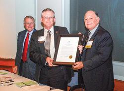 Mike Mauldin presents the TBA Chairman's Proclamation to Ignacio Urrabazo.