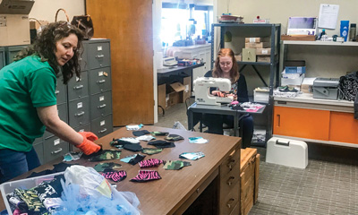 With closed lobbies and slowed business, employees at Alvord and Cooper Branches of Legend Bank make masks for healthcare workers and customers.