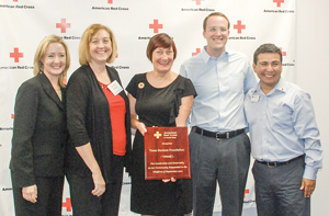 Check presentation to American Red Cross toward Bastrop wildfire relief