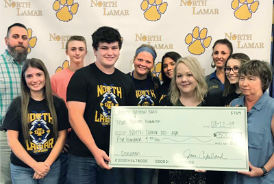 Liberty National Bank and Texas Bankers Foundation donate $500 to the North Lamar High School FFA program.